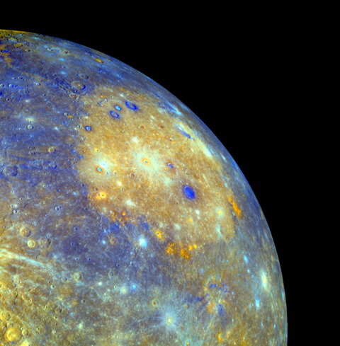 The Caloris impact basin is thought to be the remnant of an asteroid striking Mercury nearly 4 billion years ago. The different colors represent different mineral compositions on Mercury's surface. Credit: NASA/JHUAPL/CIW