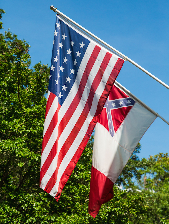 A Confederate flag flies behind the U.S. flag in Charleston, S.C., on Monday. (Darryl Brooks / Shutterstock.com)