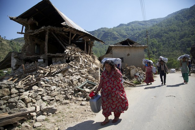 Nepalese people carry UK aid shelter kits back to the remains of their homes, 10 days after the 7.8 magnitude earthquake struck the country on 25 April 2015. Credit: Russell Watkins/DFID