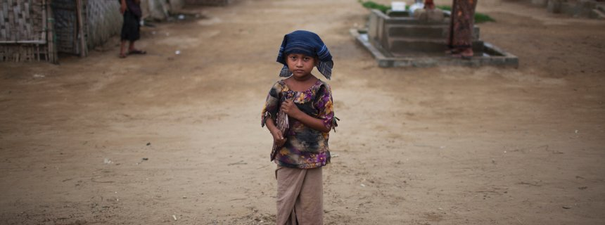 A Rohingya girl clutches a schoolbook at the Baw Du Pa camp in Sittwe Township, Myanmar (Burma), May 23, 2015.