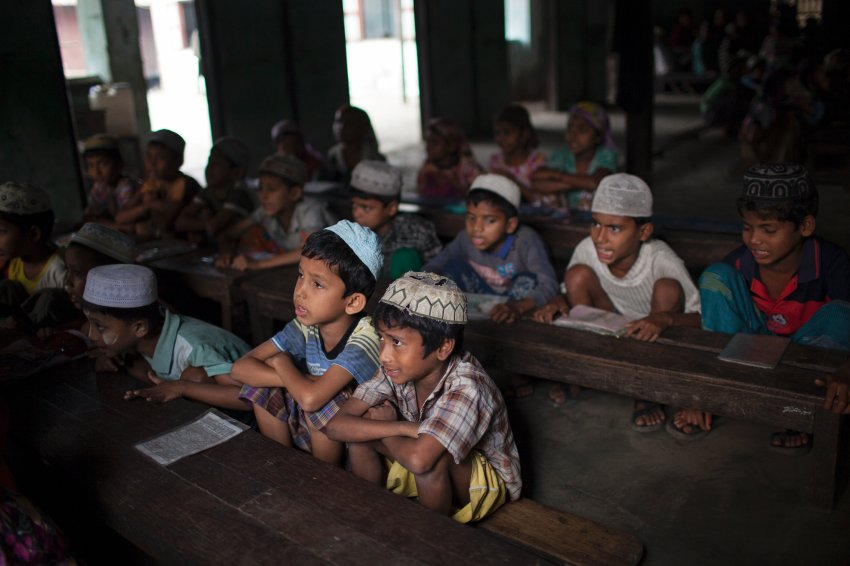Rohingya children study at a school in the Aung Mingalar ghetto in Sittwe Township, Myanmar (Burma), March 25, 2015.