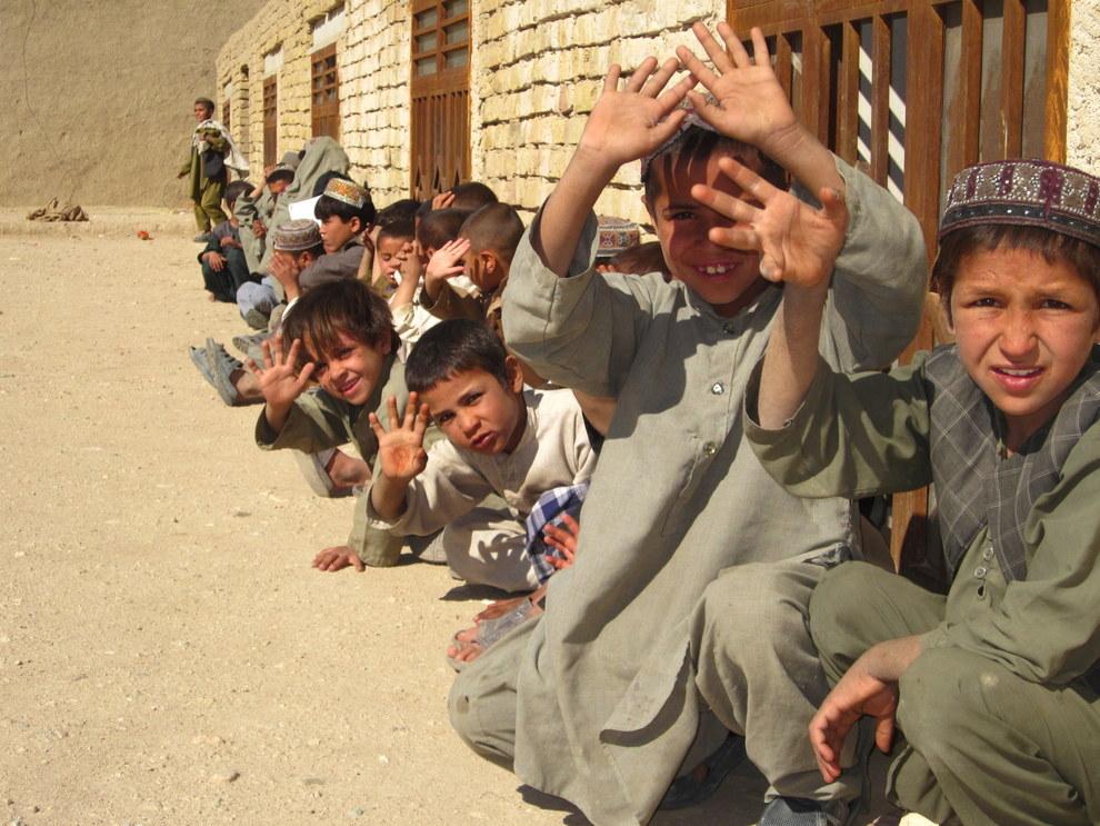 The children of Kandalay village waving in 2011 at the temporary school Joe DeNenno helped build. Courtesy Joe DeNenno