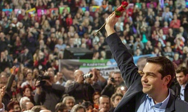 Alexis Tsipras, the prime minister of Greece, greets supporters after a rally of the governing Syriza party. Photograph: Sotiris Barbarousis/Sotiris Barbarousis/epa/Corbis