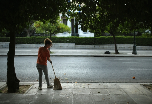 A street cleaner in Athens. Photo: Christopher Furlong/Getty