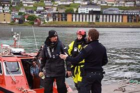 Sea Shepherd volunteer, Tom Strerath of Germany, is taken into custody. Photo: Sea Shepherd/Florian Stadler