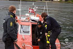 Sea Shepherd volunteer, Susan Larsen of the United States, is taken into custody. Photo: Sea Shepherd/Florian Stadler