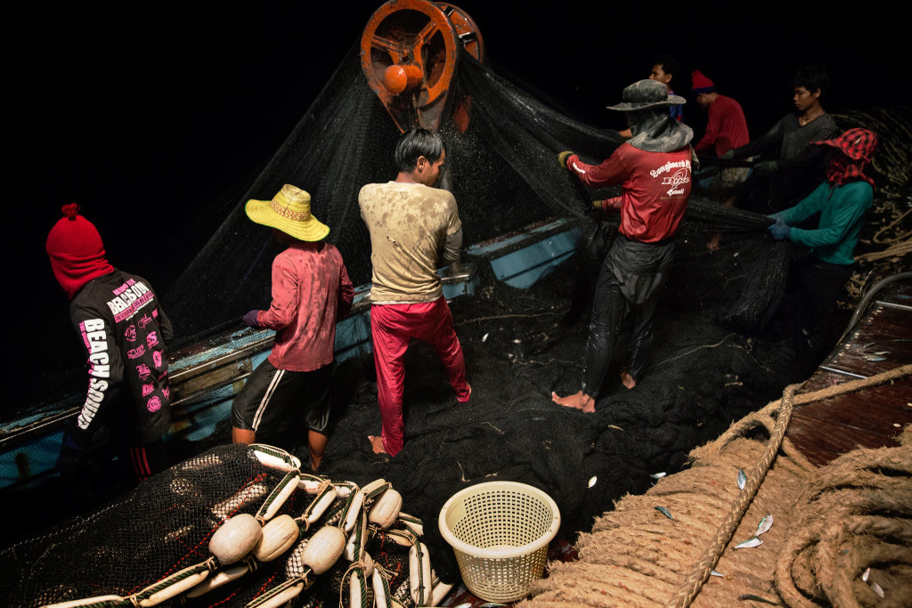 Cambodian migrants hauled in the nets on a fishing boat in the South China Sea. A labor shortage in the Thai fishing industry is primarily filled by using migrants, mostly from Cambodia and Myanmar. Credit Adam Dean for The New York Times