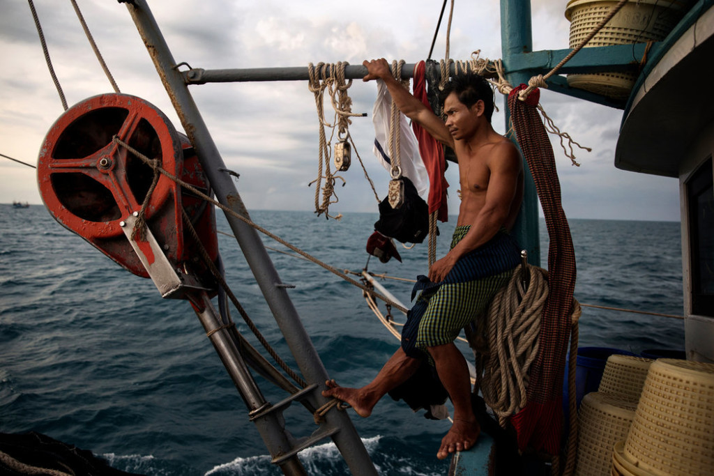 A Cambodian migrant fisherman in the South China Sea. Credit Adam Dean for The New York Times