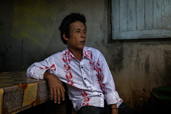 San Oo, 35, was trafficked into Thailand from Myanmar and sold to a fishing boat. He was forced to work at sea for two and a half years. Credit Adam Dean for The New York Times