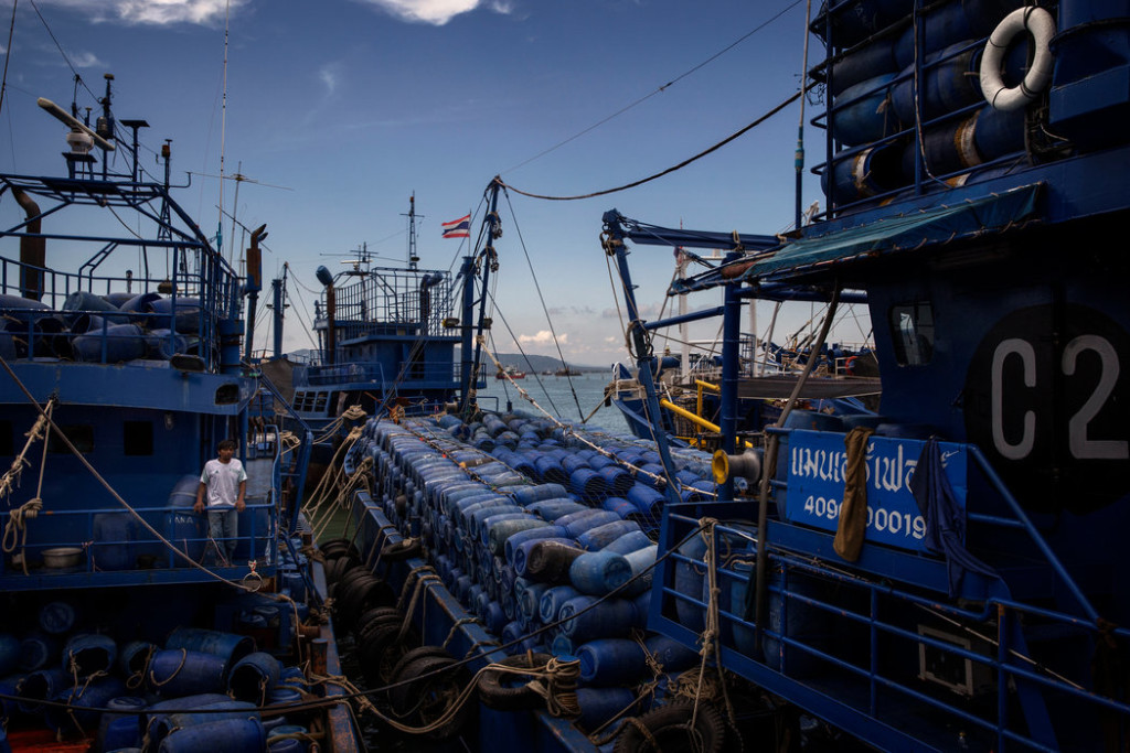 A mothership in Songkhla. These large vessels carry barrels of ice and other supplies to fishing boats in international waters. Credit Adam Dean for The New York Times