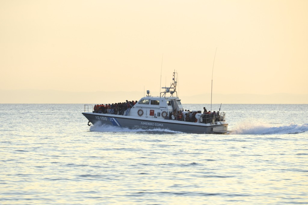 A Greek Coastguard ship rescues refugees crossing from Turkey into Europe.