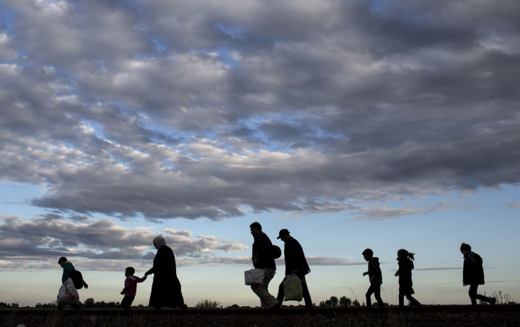 Migrants walk to a collection point in the village of Roszke, Hungary, September 6, 2015, after crossing the border from Serbia. (Marko Djurica / Reuters)