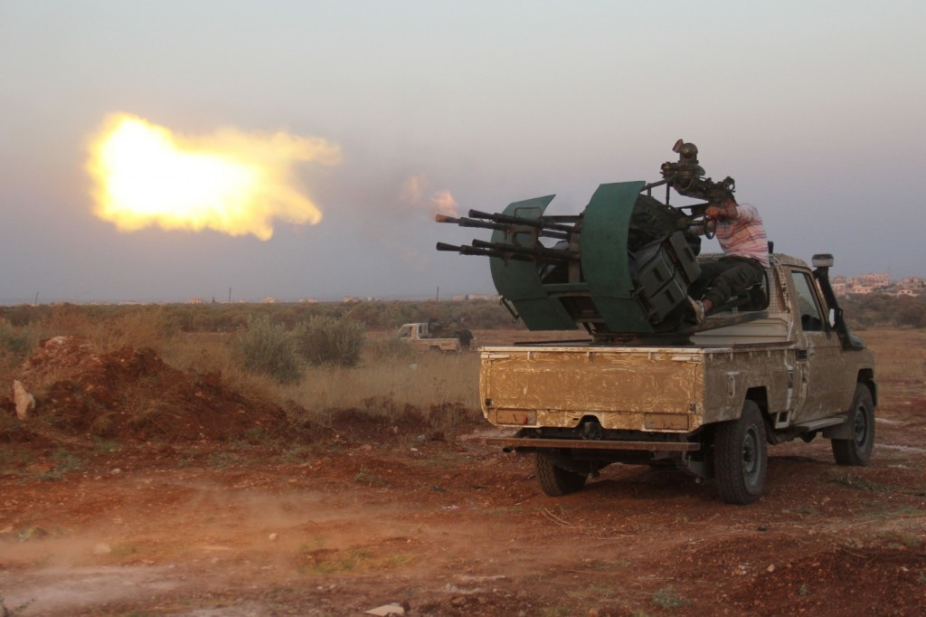 Rebel fighters fire a heavy machine gun during clashes with Syrian pro-government forces in the northwestern Idlib province, on August 31, 2015. (Omar Haj Kadour/AFP/Getty Images)