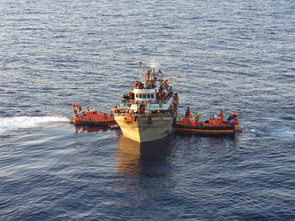 Coming to the rescue: Norwegian vessels helping a boat full of refugees and migrants as part of Frontex's Operation Triton. Photo via Flickr