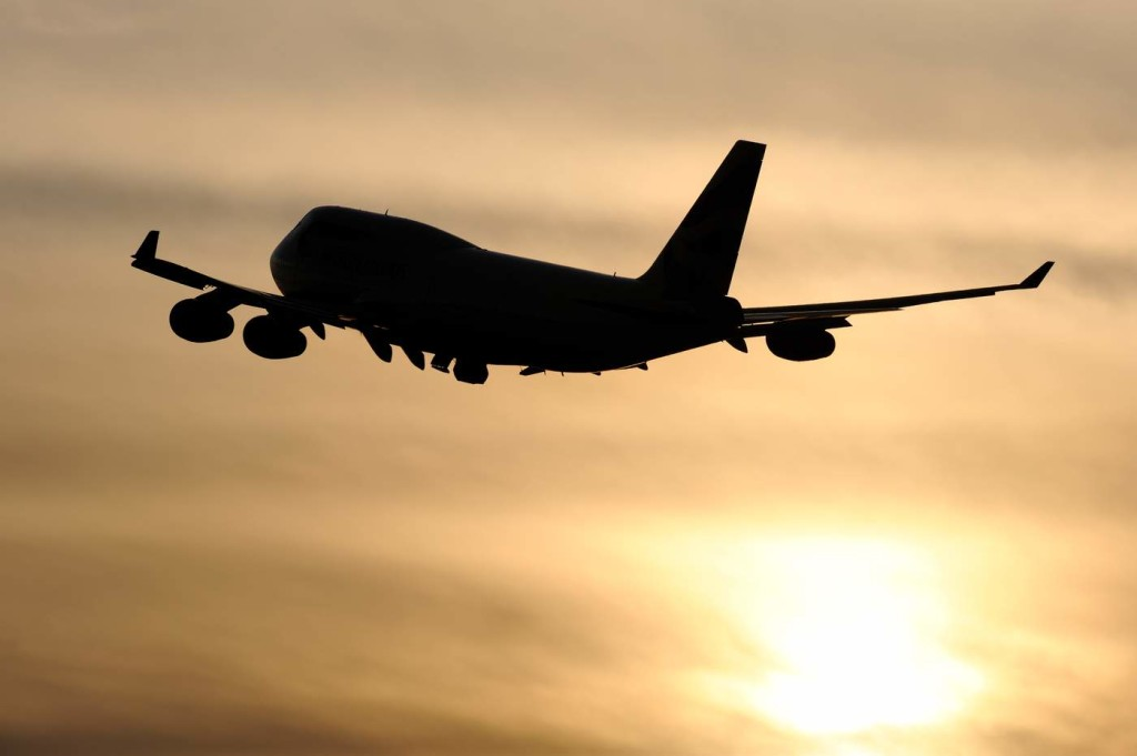 Chartered planes take failed asylum seekers back to their home countries. Photo via Flickr, stock image of plane taking off