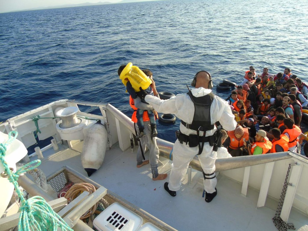 Rescued: Members of the National Criminal Investigation Service of Norway help people in the Mediterranean as part of Frontex's Operation Poseidon. Photo via