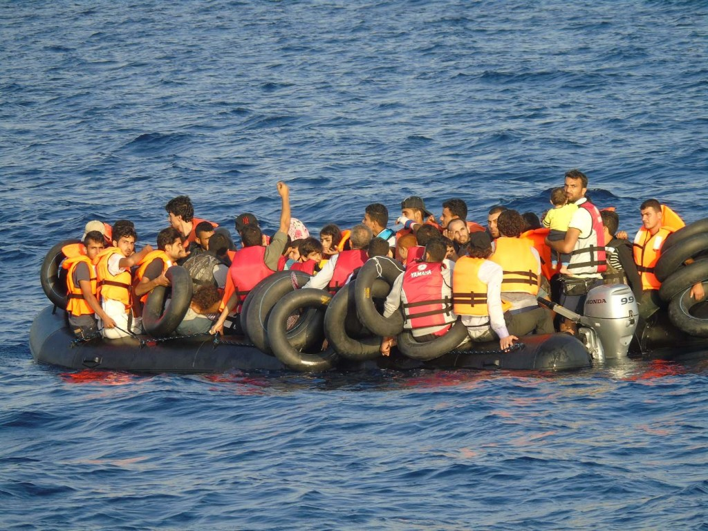 An overloaded dinghy in the Mediterranean, seen from a Norwegian ship participating in Frontex's Operation Poseidon