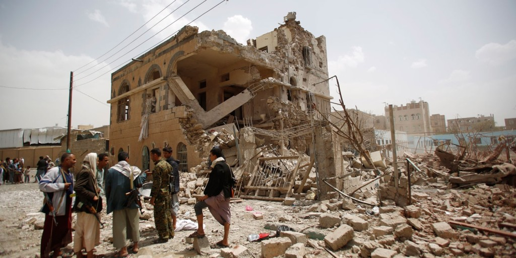 Photo: Shiite rebels known as Houthis, gather at houses destroyed by a Saudi-led airstrike in Sanaa, Yemen, July 3, 2015