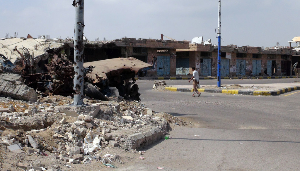 A man walks past destroyed buildings in Zinjibar, capital of Abyan province in southern Yemen on Dec. 5, 2012. Photo: Sami-al-Ansi/AFP/Getty Images