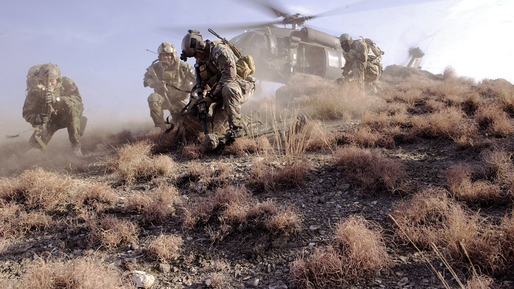 U.S. special operations personnel prepare to board a UH-60 Black Hawk helicopter during a mission in Kunar province, Afghanistan, Feb. 25, 2012. Photo: U.S. Department of Defense