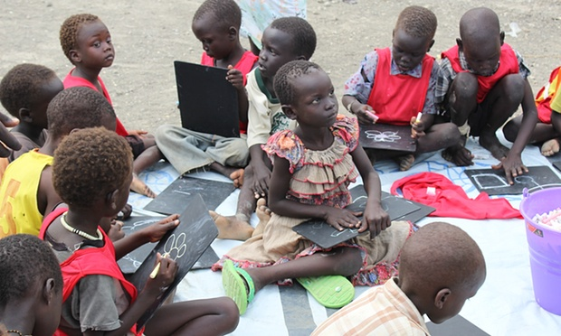In the schoolyard at the Malakal protection of civilians camp children sketch on slates with chalk. Photograph: Unicef
