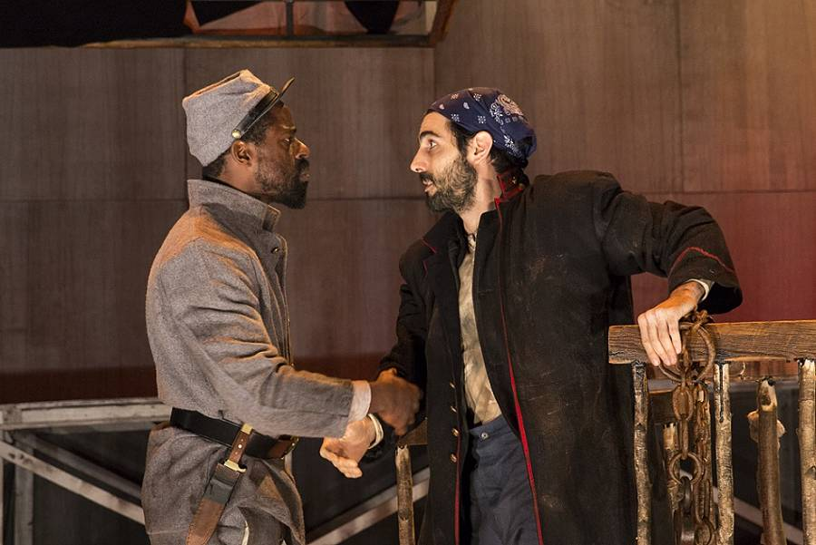 """Sterling K. Brown and Louis Cancelmi in """"Father Comes Home From the Wars (Parts 1, 2 & 3″ at the Public Theater. (Photo by Richard Termine) Featuring Cherise Boothe, Sterling K. Brown, Larry Bryggman, Louis Cancelmi, Kevin T. Carroll, Arthur French, Russell G. Jones, Jacob Ming-Trent, Tonye Patano, and Julian Rozzell, Jr.; presented by The Public Theater; photo dress rehearsal photographed: Thursday, March 13, 2014; 8:00 PM at Martinson Hall at The Public Theater; NY, NY;  Photograph: © 2014 Richard Termine  PHOTO CREDIT - Richard Termine"""