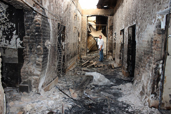 An employee surveys the charred remnants of a Doctors Without Borders hospital in Kunduz, Afghanistan, after it was hit by a U.S. airstrike in early October. Weeks later, a Doctors Without Borders hospital in Yemen was struck. (Najim Rahim / AP)