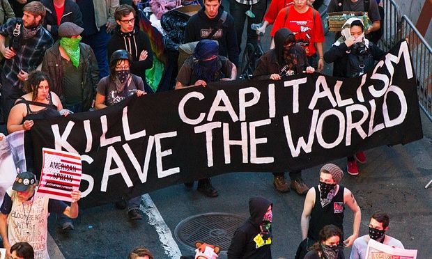 Occupy Wall Street protesters march down Broadway in 2012. Photograph: Lucas Jackson/Reuters