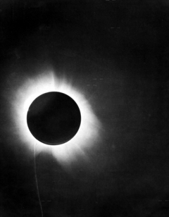 Eddington's photo of the 1919 solar eclipse showing that the background stars were out of place, in line with the predictions of general relativity