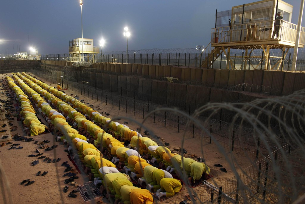 Detainees pray at Camp Bucca, a U.S.-run facility that closed in 2009. AP