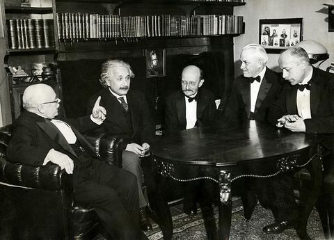From left to right: physicists W. Nernst, A. Einstein, M. Planck, R.A. Millikan and von Laue in 1931