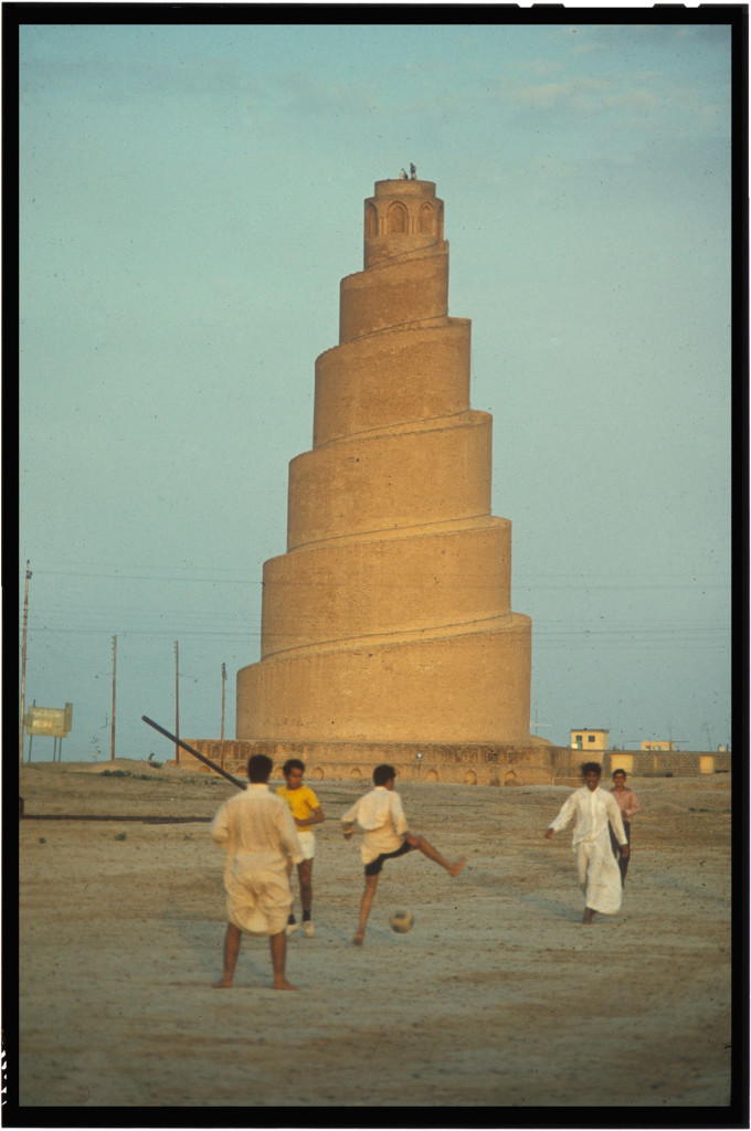 Men play soccer in front of the Great Mosque of Samarra, Baghdadi's birthplace. Alamy