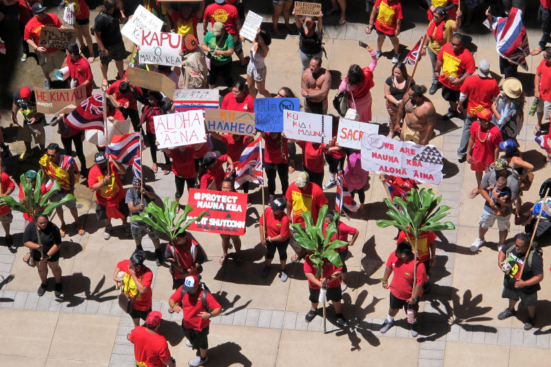 Protestors opposed to the TMT gather outside the Hawaiian Legislature on April 21st, 2015. Image Credit: AP Photo/Cathy Bussewitz