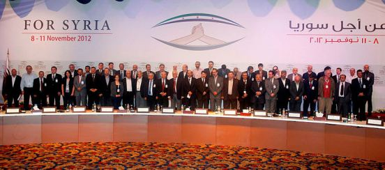 Coalition members in Doha. In the center, former president al-Khatib, along with former VPs Seif and Atassi, as well as all SNC chairmen Ghalioun, Sieda and Sabra | 18 November 2012 | Creative Commons Attribution-Share Alike 2.0 Generic license. | Wikimedia Commons