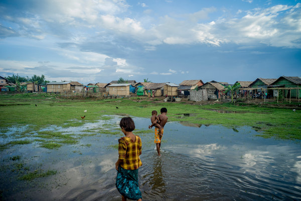 Children near their homes in one of the concentration camps where Myanmar has locked away a Muslim minority called the Rohingya. Credit Tomas Munita for The New York Times