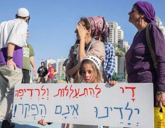 "Gaining a Voice: Demonstrators at a Petah Tikva courthouse in December protest the alleged torture of suspected Jewish extremists. Israeli security forces deny the charge. The sign reads: ""Enough with abuse and persecution, don't abandon our children."" - Getty Images"