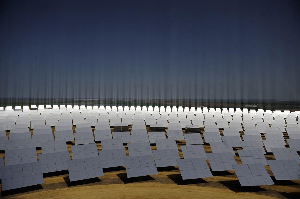 Solar panels facing a solar tower taken in Sanlucar de Barrameda, Spain. (Cristina Quicler/AFP/Getty Images)