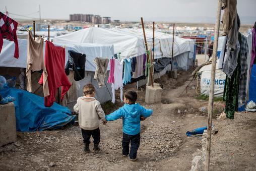 Iraq, 2014: Syrian boys in Domiz refugee camp, in the northern Dohuk Governorate. Over 2.8 million people have now fled the conflict in the Syrian Arab Republic, seeking refuge in nearby Egypt, Iraq, Jordan, Lebanon and Turkey. Many of these refugees continue to face inadequate access to basic services, such as education, health care, water and sanitation – a risk that is even greater for the 85 per cent of Syrian refugees living outside formal camps. | Credit: UNICEF