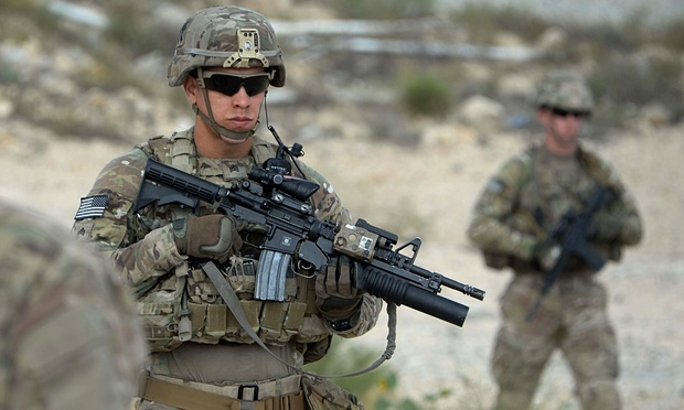 US soldiers patrol in Afghanistan. President Barack Obama announced last year that thousands of US troops will remain in the country past 2016, retreating from a major campaign pledge. Photograph: Noorullah Shirzada/AFP/Getty Images