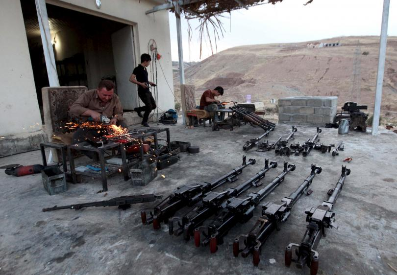 A Kurdish man repairs weapons for Peshmerga forces fighting against ISIS militants, in his shop outside of Irbil, Iraq, Sept. 15, 2015. Photo: Reuters/Azad Lashkari