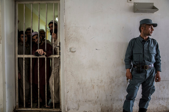 Afghans accused of smuggling opium were held last year in Zaranj, the capital of Nimruz Province, where Mullah Abdul Rashid Baluch was the Taliban shadow governor. Credit Bryan Denton for The New York Times