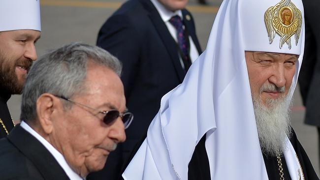 Cuban president Raul Castrow, left, with Russian Orthodox Patriarch Kirill at Jose Marti International airport in Havana.