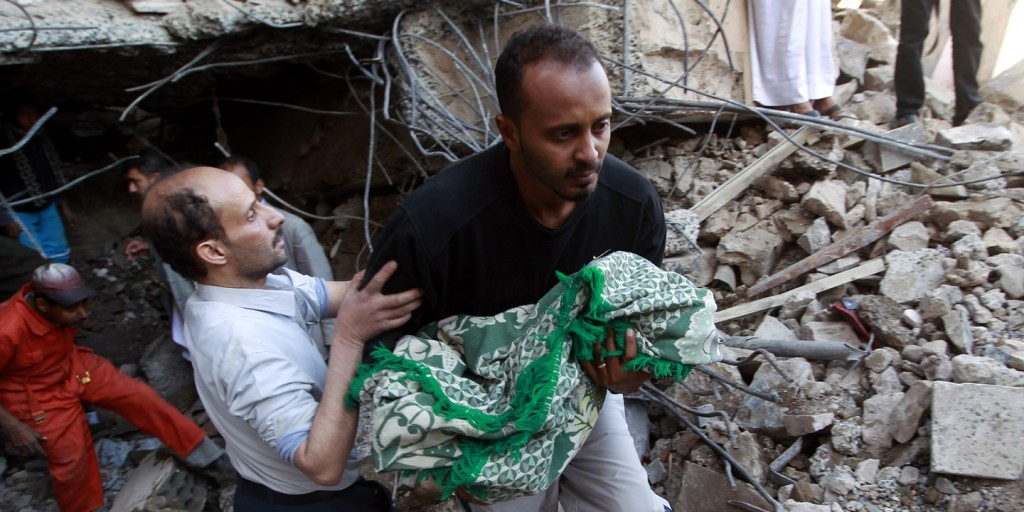 Yemeni rescuers carry the body of a baby girl who was retrieved from the rubble after a building was struck overnight by Saudi-led coalition airstrikes on Feb. 10, 2016, in the capital, Sanaa.