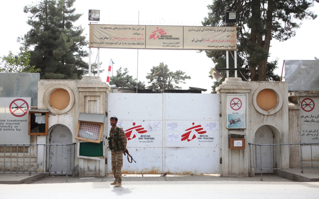 A police officer stands guard in front of the Médecins Sans Frontières hospital destroyed by a U.S. airstrike in Kunduz, Afghanistan, Oct. 11, 2015. Photo: Omid/Xinhua/Newscom