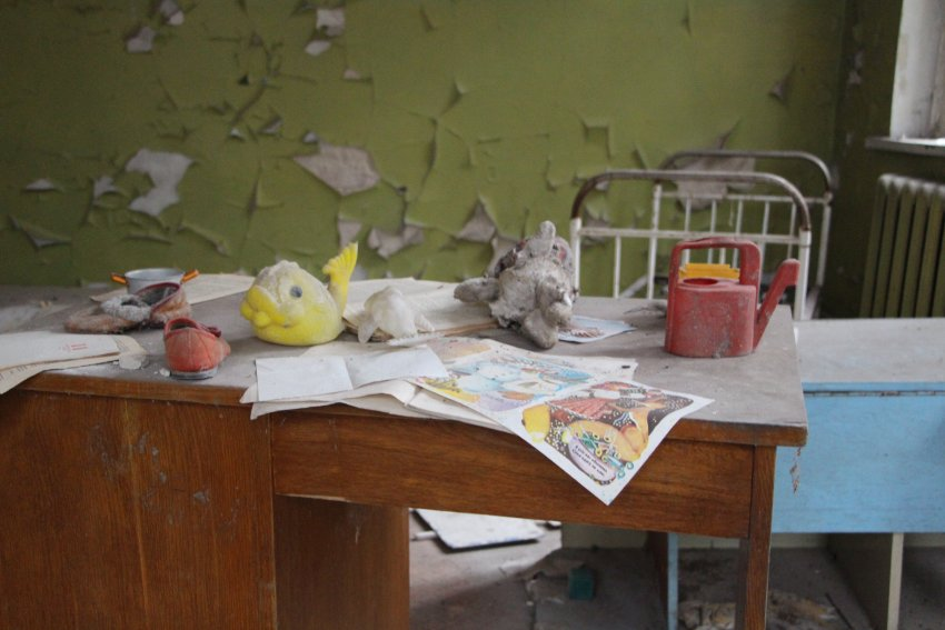 In an evacuated school inside the Chernobyl exclusion zone, yellowed school books still sit on the desks, Soviet propaganda hangs on the walls and there are several gas masks lying about. Sometimes it almost seems as if items had been arranged over the last three decades with visitors in mind.