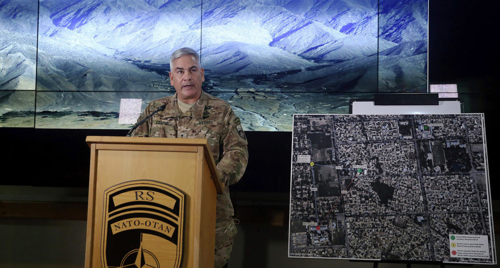 Gen. John F. Campbell, commander of U.S. and NATO forces in Afghanistan, stands beside a map of the city of Kunduz as he addresses a press conference at Resolute Support headquarters in Kabul on Nov. 25, 2015. Photo: Massoud Hossaini/AFP/Getty Images
