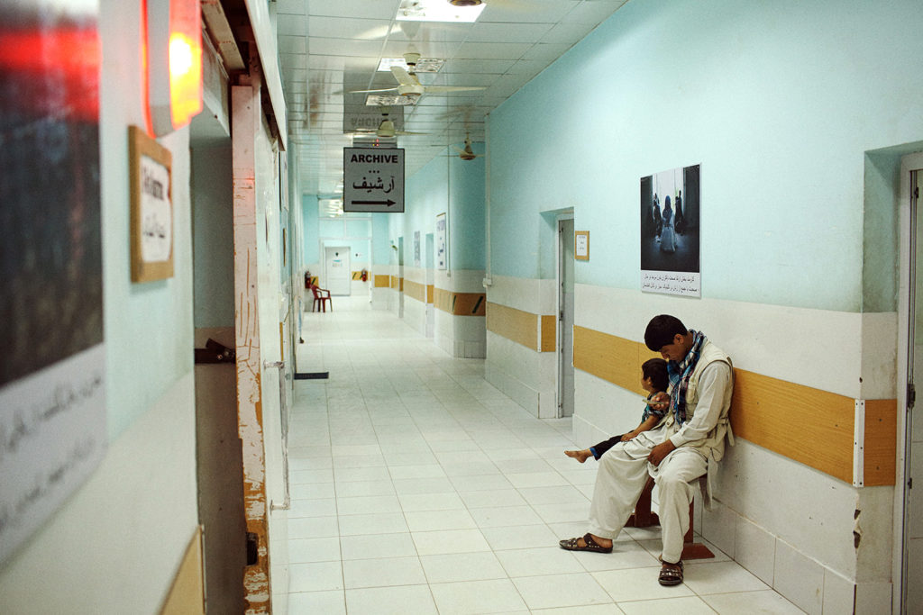 A young patient waits to be X-rayed with her father at the Kunduz Trauma Center run by Médecins Sans Frontières, May 20, 2015. Photo: Andrew Quilty/Oculi