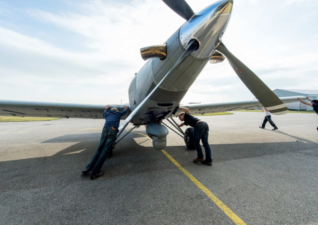 Airborne technicians in Austria work on the surveillance gear attached to one of the Thrush airplanes. Photo obtained by The Intercept