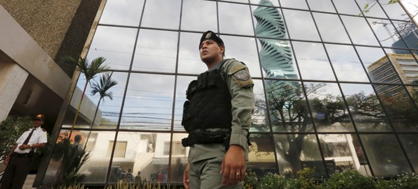 A police officer stands outside the headquarters of Mossack Fonseca while prosecutors raid the offices in Panama City on April 12, 2016. (photo: Carlos Jasso/Reuters)