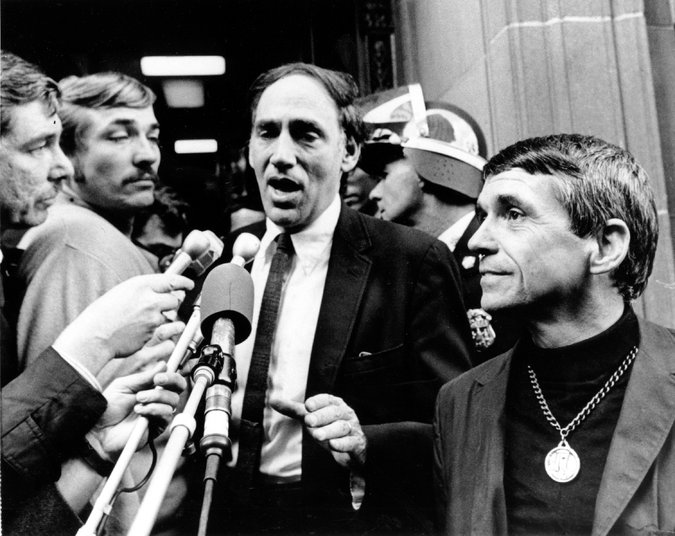 Father Berrigan, right, and a defense lawyer, William M. Kunstler, center, after he was sentenced to three years in federal prison in Danbury, Conn. Credit Associated Press